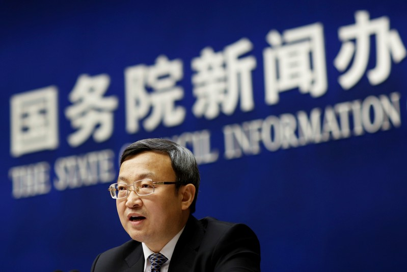 FILE PHOTO: Chinese Vice Commerce Minister and Deputy China International Trade Representative Wang Shouwen attends a news conference in Beijing