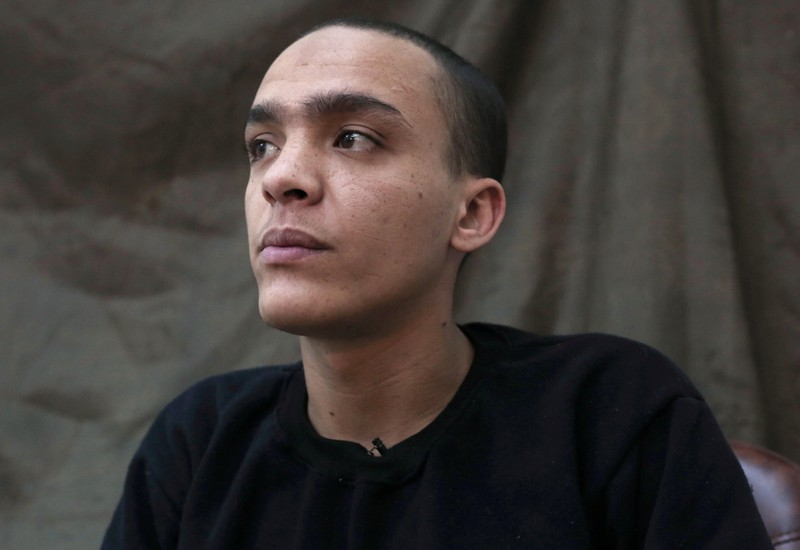 Mounsef al-Mkhayar, 22, an Islamic state fighter of Morrocan descent and Italian citizenship, gestures during an interview with Reuters, in Qamishli