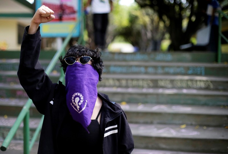 FILE PHOTO: A masked demonstrator shouts slogans against Nicaraguan President Daniel Ortega's government during a protest to mark International Women's Day at UCA in Managua