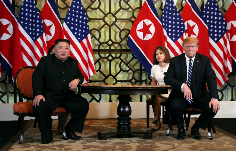 FILE PHOTO: North Korean leader Kim Jong Un and U.S. President Donald Trump listen to questions from the media during the one-on-one bilateral meeting at the second North Korea-U.S. summit in the Metropole hotel in Hanoi