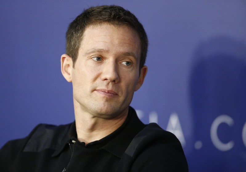 FILE PHOTO: World Rally Champion Ogier listens during the FIA news conference in St. Petersburg