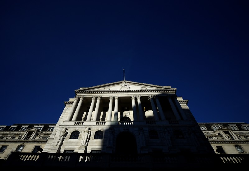 An adjacent building throws a shadow accross the Bank of England in the City of London