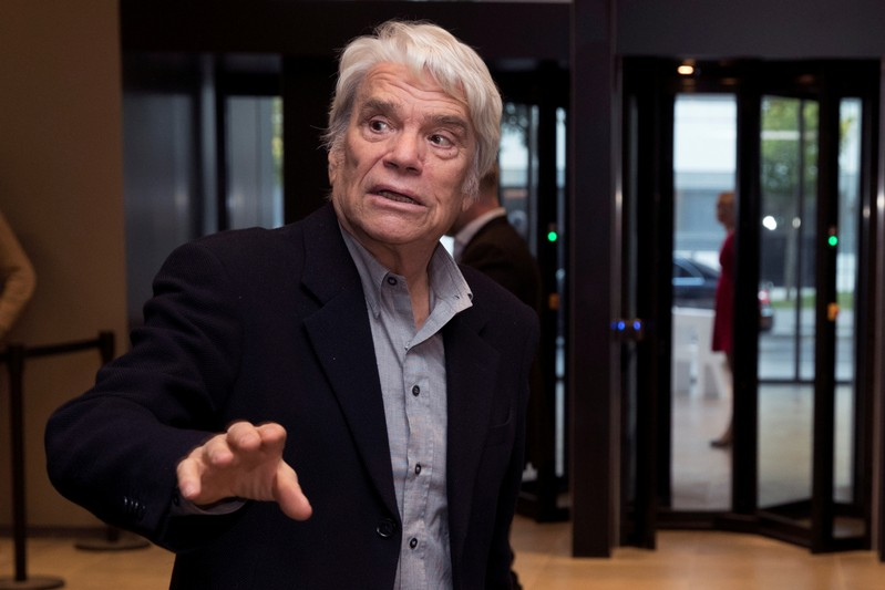 FILE PHOTO: French businessman Bernard Tapie arrives to attend the inauguration of the Altice Campus in Paris