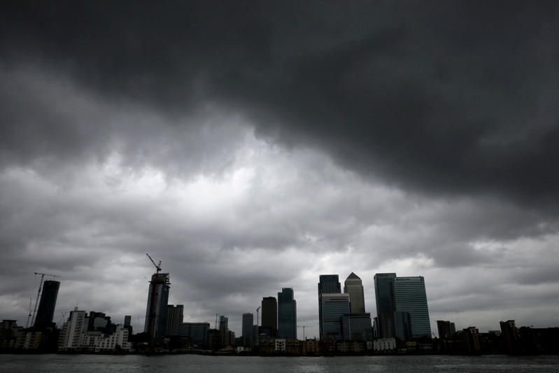 FILE PHOTO: Rain clouds pass over Canary Wharf financial financial district in London