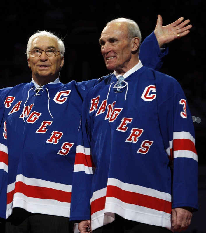 Former New York Rangers Howell and Bathgate smile during number retirement ceremony before Rangers' game against Maple Leafs in New York