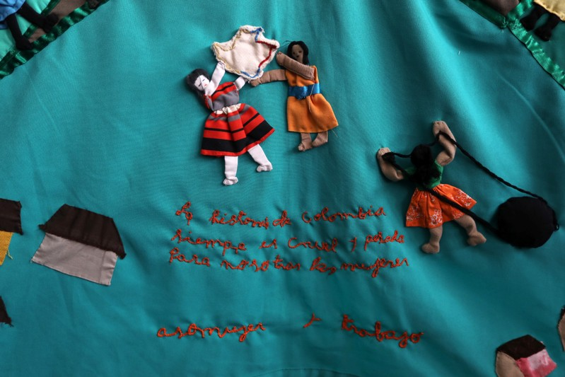 A cloth embroidered by the victims of the armed conflict in Colombia, with the phrase that reads: