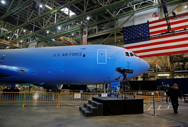 FILE PHOTO: The Boeing KC-46 Pegasus aerial refueling tanker is bathed in blue light before a delivery celebration to the U.S. Air Force in Everett, Washington