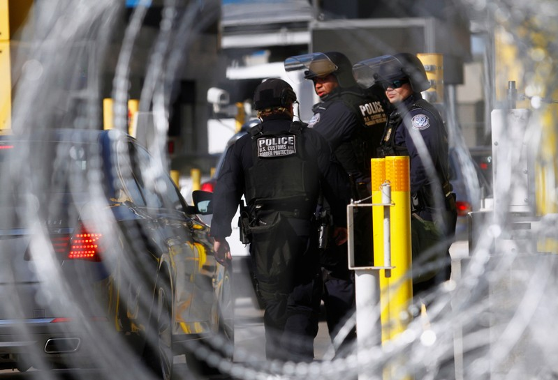 FILE PHOTO - U.S. Customs and Border Protection agents participate in a test deployment during a large-scale operational readiness exercise at the San Ysidro port of entry with Mexico in San Diego, California, U.S, as seen from Tijuana