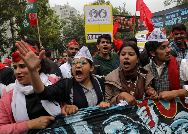 Demonstrators shout slogans as they participate in a march demanding jobs and better education facilities, in New Delhi