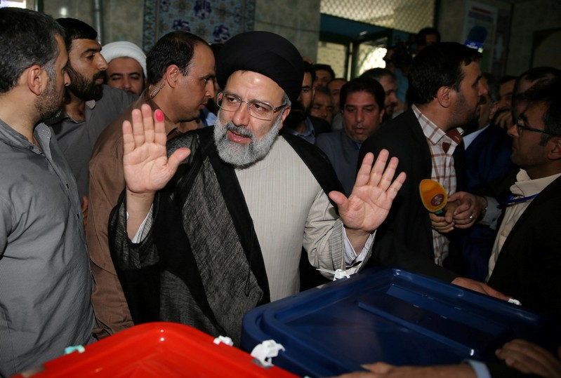 FILE PHOTO: Iranian presidential candidate Ebrahim Raisi gestures as he casts his vote during the presidential election in Tehran