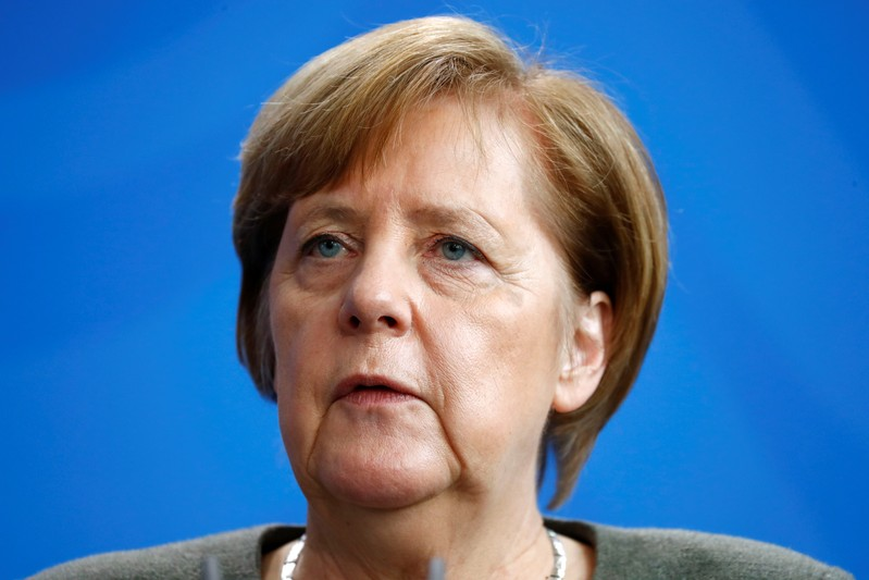 German Chancellor Angela Merkel attends a news conference at the Chancellery in Berlin