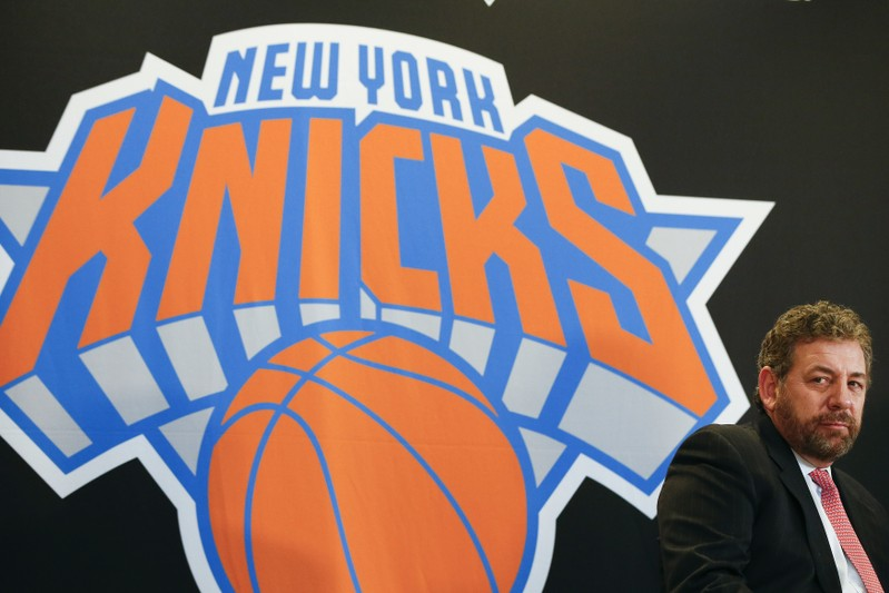 FILE PHOTO: New York Knicks owner Dolan looks on during a news conference announcing Phil Jackson as the team president of the New York Knicks basketball team at Madison Square Garden in New York
