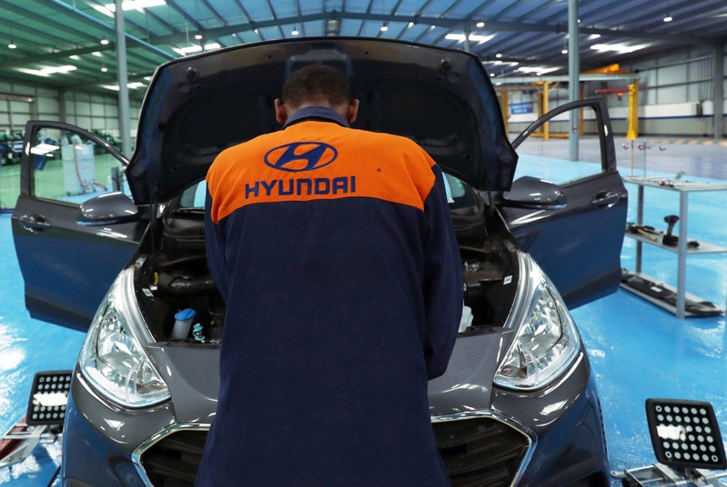 FILE PHOTO: An employee assembles a Hyundai car in Hyundai Marathon Motor assembly plant on the outskirt of Addis Ababa