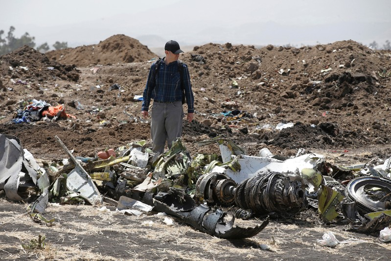 American civil aviation and Boeing investigators search through the debris at the scene of the Ethiopian Airlines Flight ET 302 plane crash, near the town of Bishoftu, southeast of Addis Ababa