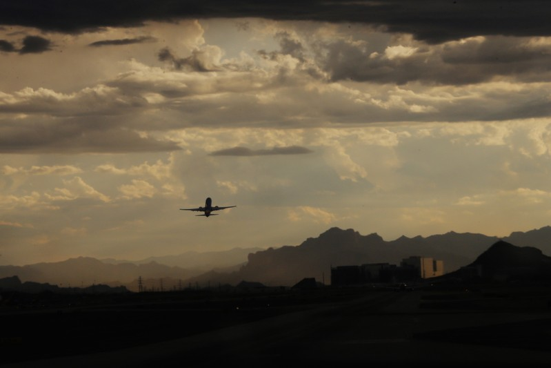 A commercial flight takes off from Phoenix Sky Harbor International Airport in Phoenix