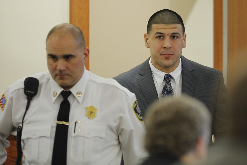 Former New England Patriots football player Aaron Hernandez arrives in the courtroom at Bristol County Superior Court in Fall River