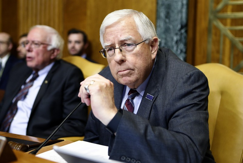 Chairman of the Senate Budget Committee Enzi waits for order to be restored during markup of the FY2018 Budget reconciliation legislation on Capitol Hill in Washington