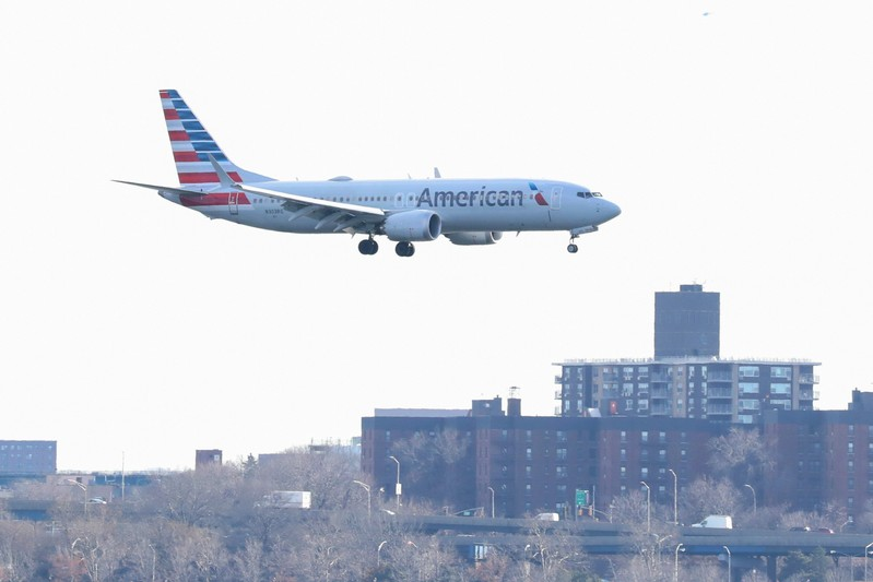 FILE PHOTO: An American Airlines Boeing 737 Max 8, on a flight from Miami to New York City, comes in for landing at LaGuardia Airport in New York