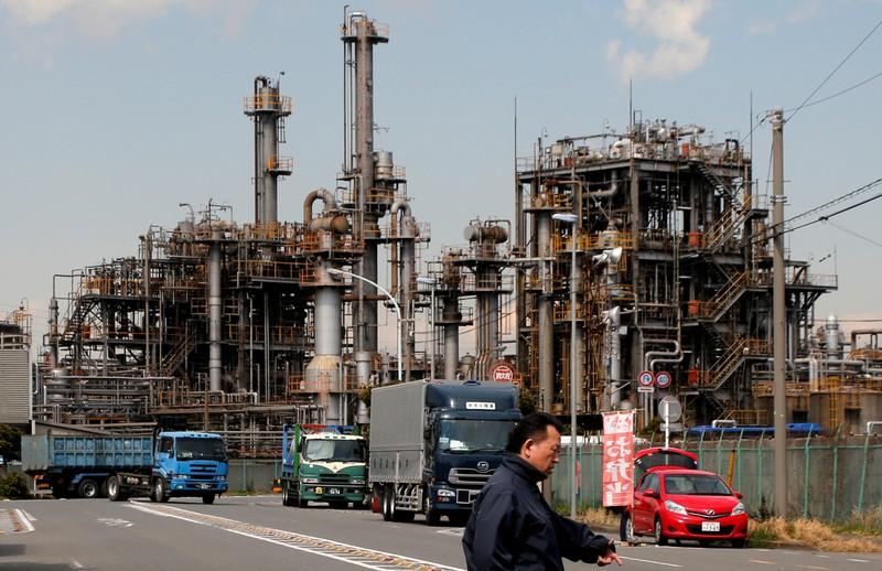 FILE PHOTO: Worker walks near a factory at the Keihin industrial zone in Kawasaki