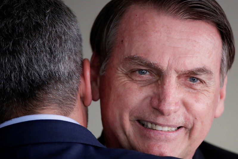 Brazil's President Jair Bolsonaro is greeted by Paraguay's President Mario Abdo after a meeting at the Itamaraty Palace in Brasilia