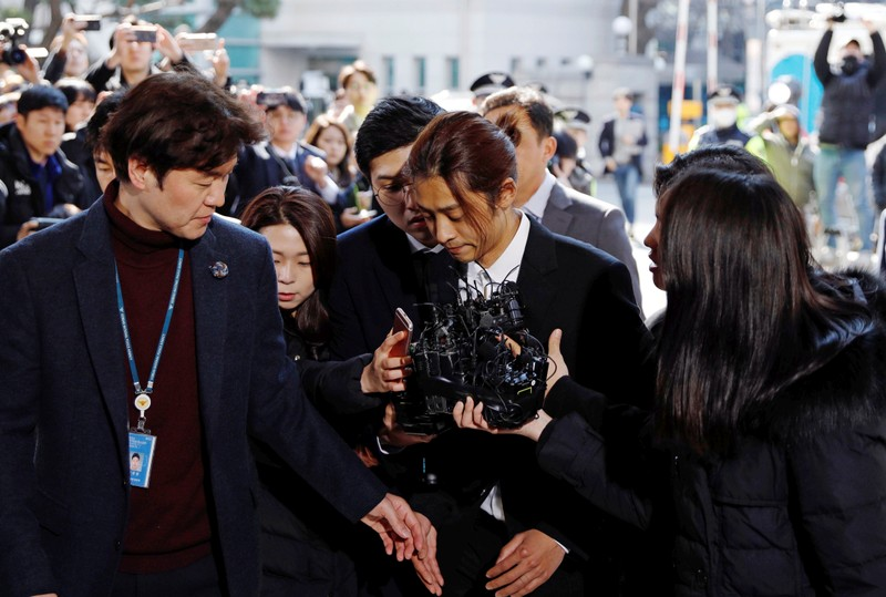 South Korean singer Jung Joon-young arrives for questioning on accusations of illicitly taping and sharing sex videos on social media, at the Seoul Metropolitan Police Agency in Seoul
