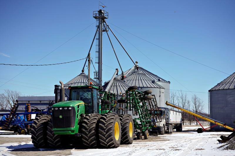 Farm equipment and grain storage belonging to farmer Austin Rincker sit outside in Moweaqua Illinois