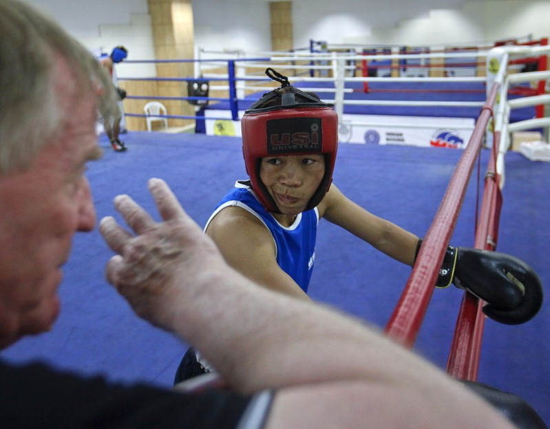 FILE PHOTO: India's boxer MC Mary Kom listens to her coach during a training session in Pune