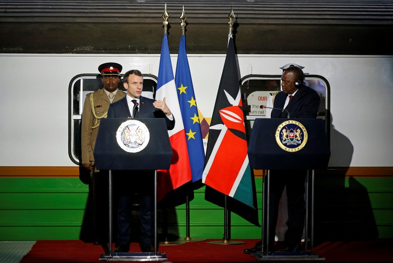 French President Emmanuel Macron flanked by Kenya's President Uhuru Kenyatta address a news conference after touring the Nairobi Central Railway in Nairobi,