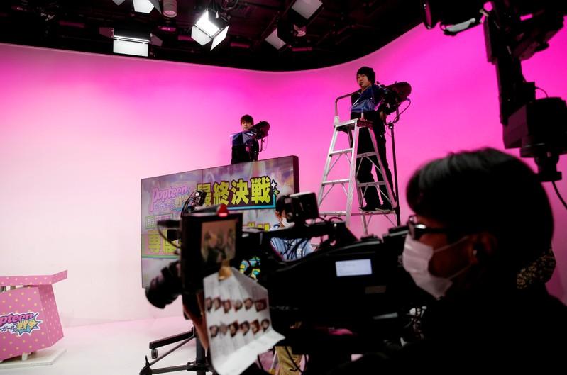 AbemaTV's staffs prepare for filming at its studio in Tokyo