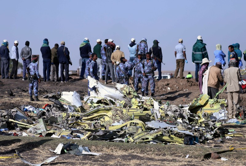 Ethiopian Federal policemen stand at the scene of the Ethiopian Airlines Flight ET 302 plane crash, near the town of Bishoftu