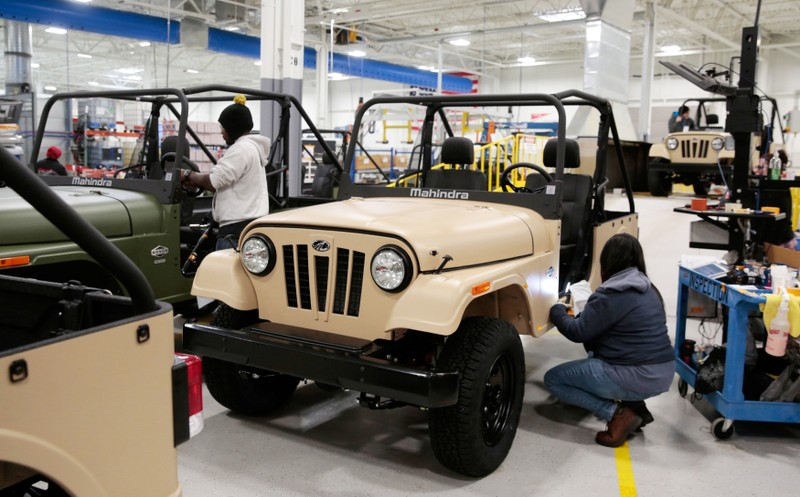 Mahindra Automotive North America quality control workers inspect ROXOR off-road vehicles at the MANA assembly plant in Auburn Hills