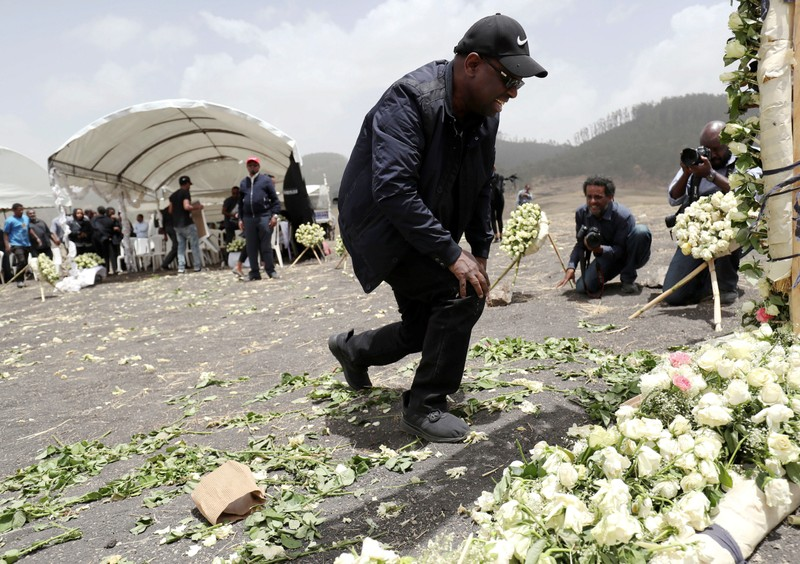 A relative mourns at the scene of the Ethiopian Airlines Flight ET 302 plane crash, near the town Bishoftu