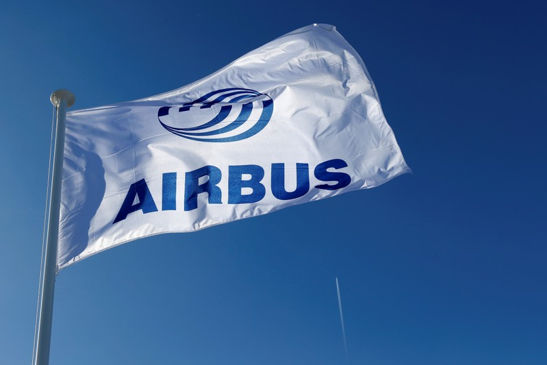 A logo of Airbus is seen on a flag at Airbus headquarters in Blagnac