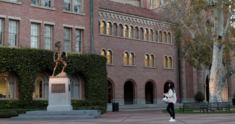 A person walks by the Trojan Shrine at University of Southern California in Los Angeles