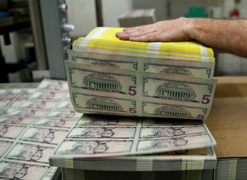 FILE PHOTO: Sheets of Lincoln five dollar bill are fanned out at the Bureau of Engraving and Printing in Washington
