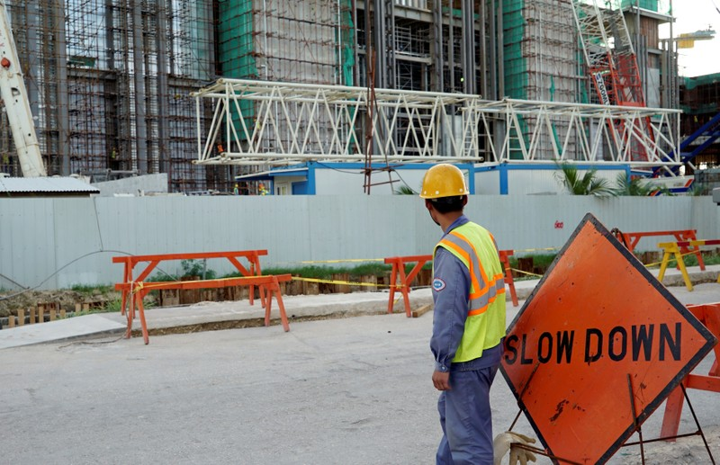 FILE PHOTO: A worker stands outside the construction site of the new Best Sunshine Live casino at Saipan