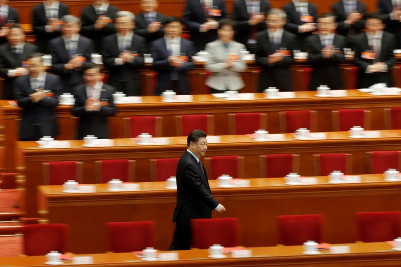 Chinese President Xi Jinping arrives for the closing session of the National People's Congress (NPC) at the Great Hall of the People in Beijing