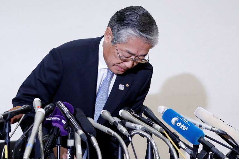 Tsunekazu Takeda, President of the Japanese Olympic committee, bows as he attends a news conference in Tokyo, Japan