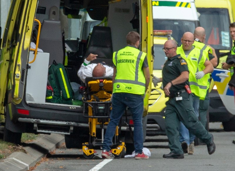 An injured person is loaded onto an ambulance following a shooting at the Al Noor mosque in Christchurch