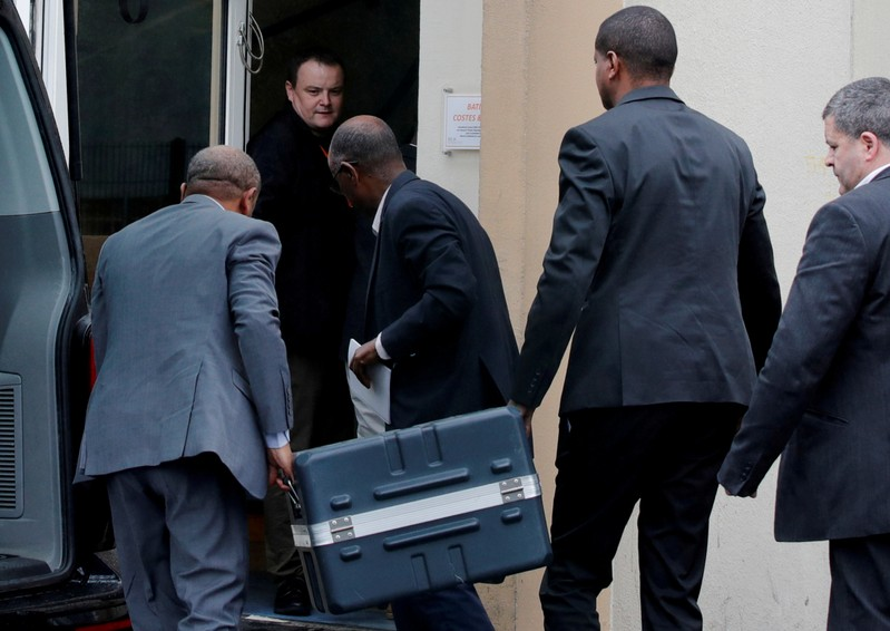 FILE PHOTO: Men unload a case containing the black boxes from the crashed Ethiopian Airlines Boeing 737 MAX 8 outside the headquarters of France's BEA air accident investigation agency in Le Bourget