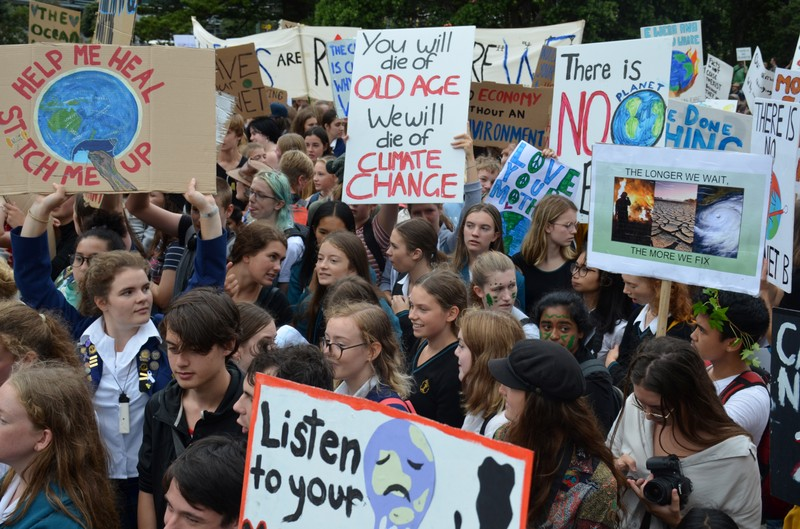 Students are seen during the global school strike for action on climate change outside New Zealand's parliament in Wellington