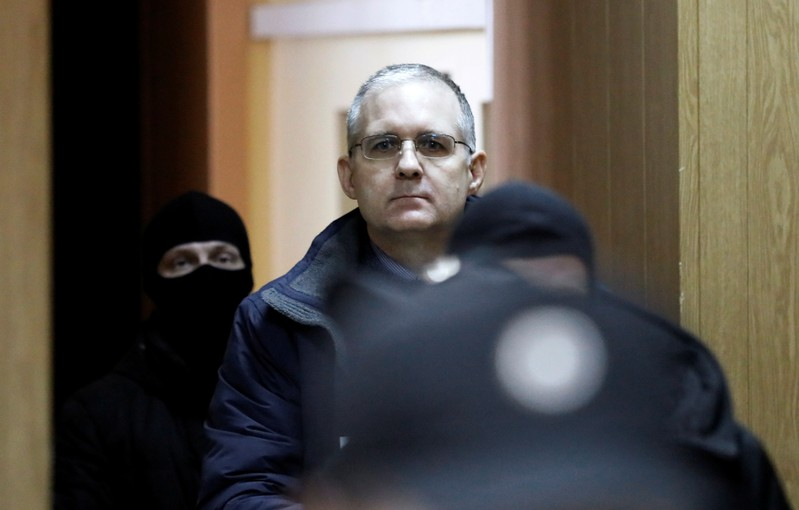 Former U.S. marine Paul Whelan who is being held on suspicion of spying, is escorted out of a courtroom after a ruling regarding extension of his detention, in Moscow