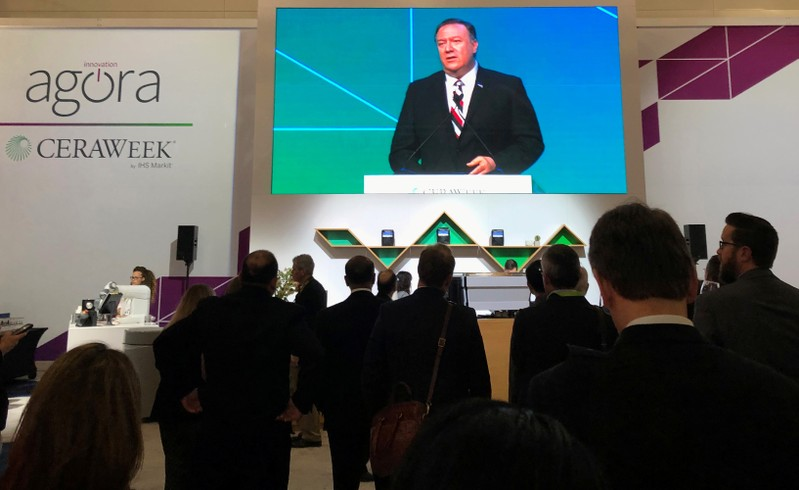 Attendees at IHS Markit's CERAWeek conference watch the keynote address by U.S. Secretary of State Mike Pompeo from the George Brown Convention Center in Houston