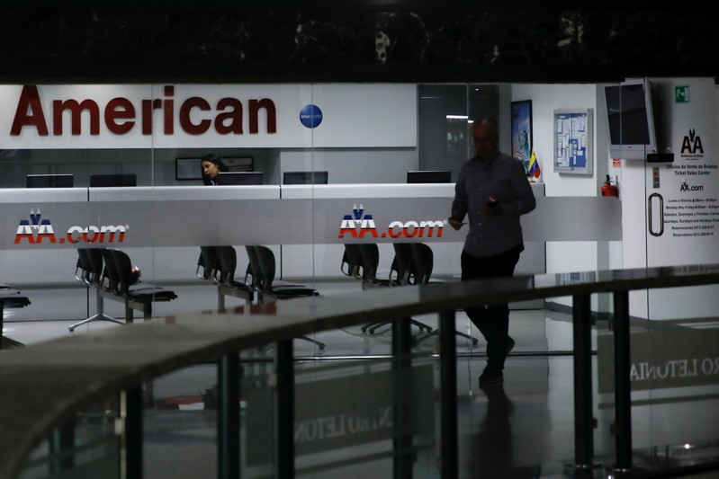 A man walks past the American Airlines office in Caracas