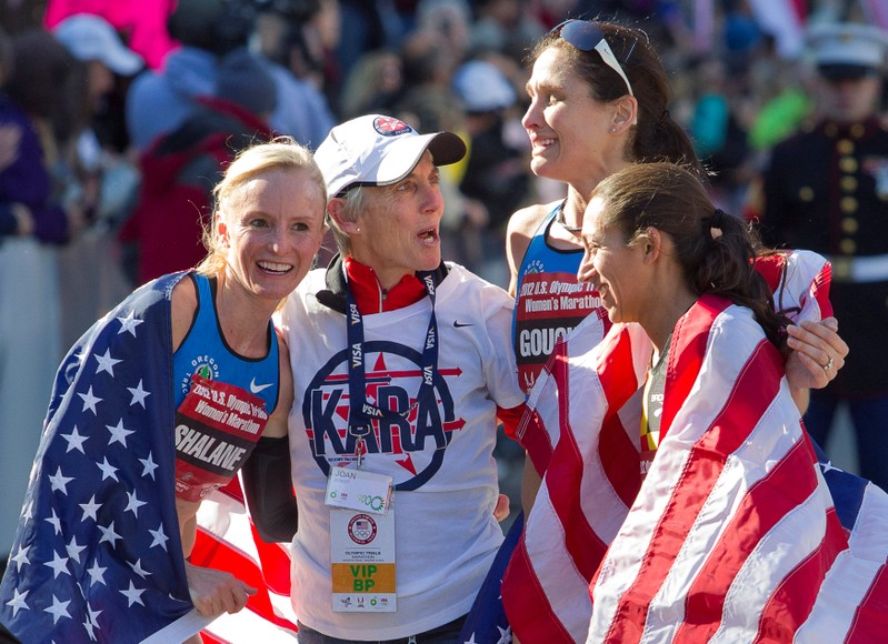 FILE PHOTO: Benoit Samuelson congratulates the top three women finishersat the finish line of the U.S. Olympic Trials Marathon in Houston