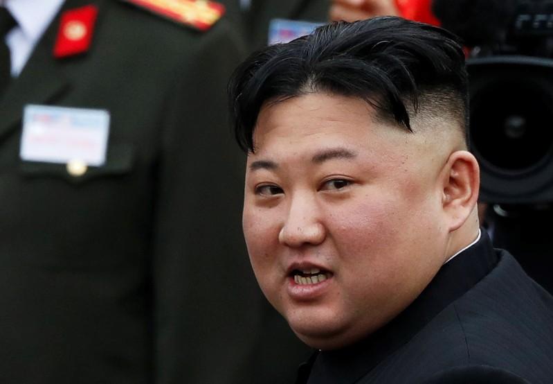North Korean leader Kim Jong Un makes his way to board a train to depart for North Korea at Dong Dang railway station