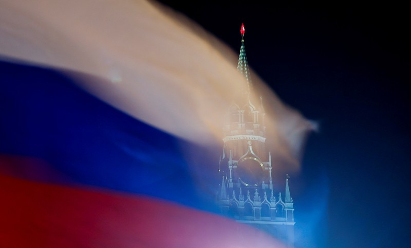 FILE PHOTO: A Russian flag flies with the Spasskaya tower of Moscow's Kremlin in the background