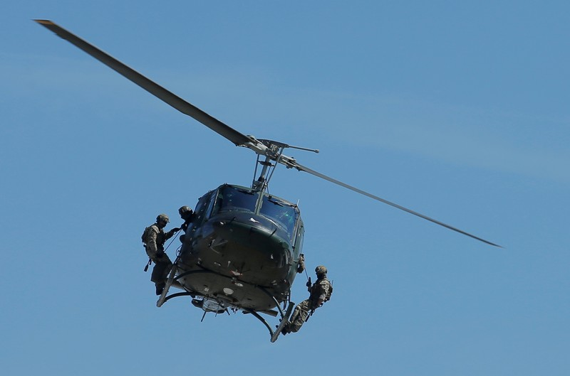 FILE PHOTO: Members of Austrian special operations unit Jagdkommando perform an exercise on an Agusta Bell 212 helicopter in Wiener Neustadt