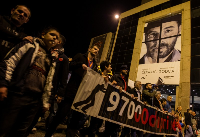 Demonstrators march during civic protest in Podgorica