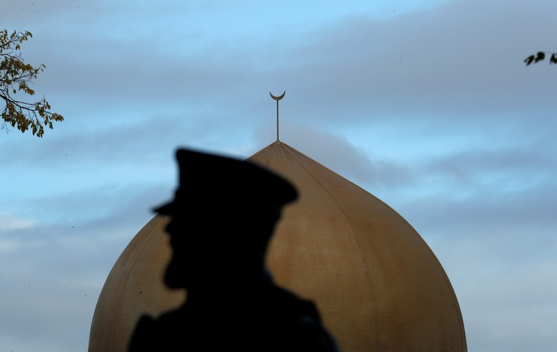 A police officer is pictured outside Masjid Al Noor mosque in Christchurch